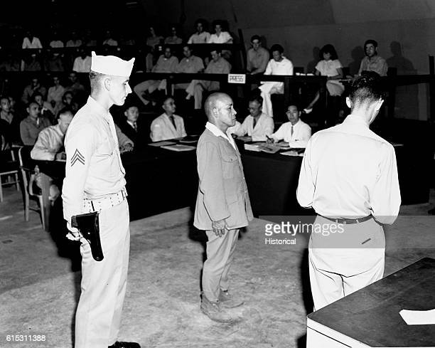 Vice Admiral Kunzio Mori listens as a sentence of life imprisonment is pronounced for committing acts of cannibalism on American prisoners
