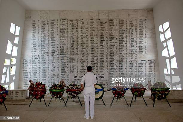 Vice Admiral Michael Vitale pauses for a moment in the shrine room of the USS Arizona Memorial during a memorial service for the 69th anniversary of...
