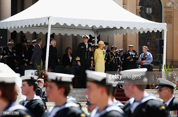 Vice Admiral Ray Griggs Chief of Navy and the GovernorGeneral Quentin Bryce look on from Town Hall steps as Navy Personnel parde down George Street...