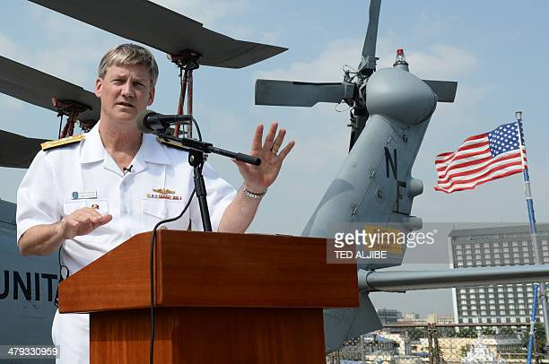 Vice admiral Robert Thomas Jr Seventh Fleet commander speaks during a press conference aboard USS Blue Ridgecommand ship shortly after arriving at...