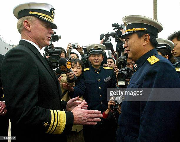 Vice Admiral Robert Willard , the commander of US Seventh Fleet, chats with Vice Admiral Zhao Guojun , the commander of the Eastern China Sea Fleet,...