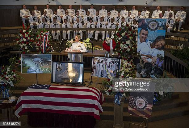 Vice Admiral Robin Braun commander of Navy Reserve Force speaks during the funeral service for Logistics Specialist 2nd Class Randall Smith...