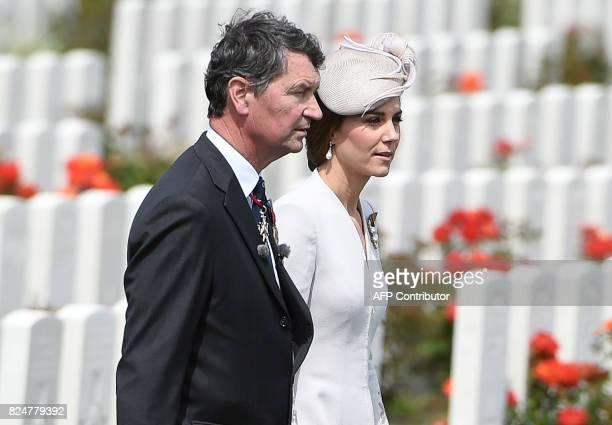 Vice Admiral Sir Timothy Laurence and Britain's Princess Catherine Duchess of Cambridge walk past headstones of soldiers who fell in World War One at...
