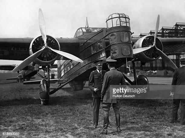 Vice Air Marshal Jobert de la Ferte and General Massenet de la Maraucourd of the French Air Force converse in front of a Marcel Bloch bomber at a...