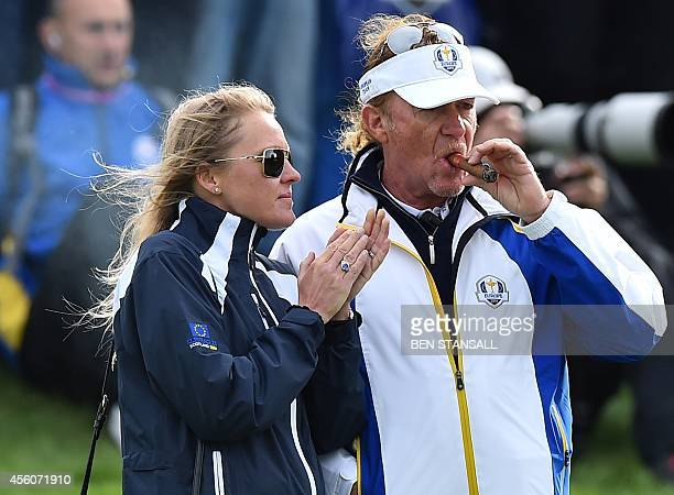 Vice Captain of Team Europe Miguel Angel Jimenez of Spain and his wife Susanna Styblo are pictured during a practice session at the Gleneagles golf...