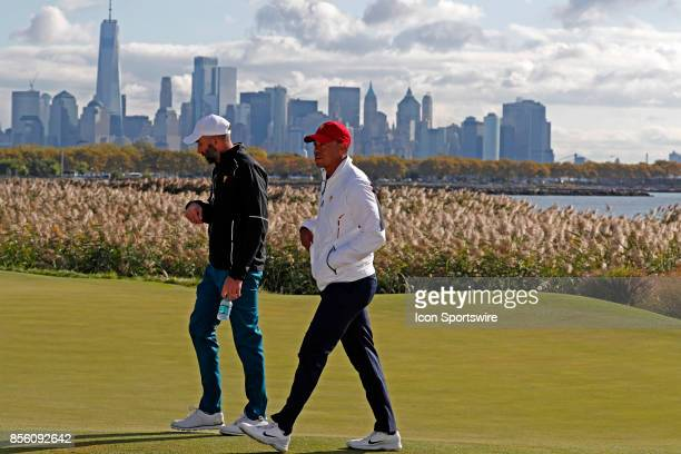 USA vice captain Tiger Woods walks the 10th hole with the New York skyline in the background during the third round of the Presidents Cup at Liberty...