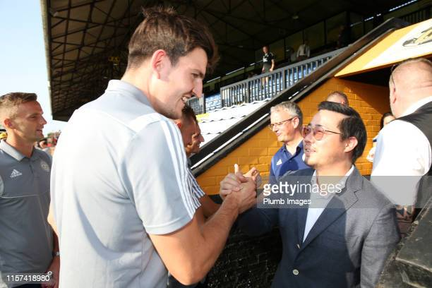 Vice Chairman Aiyawatt Srivaddhanaprabha of Leicester with Harry Maguire of Leicester City ahead of the PreSeason Friendly match between Cambridge...