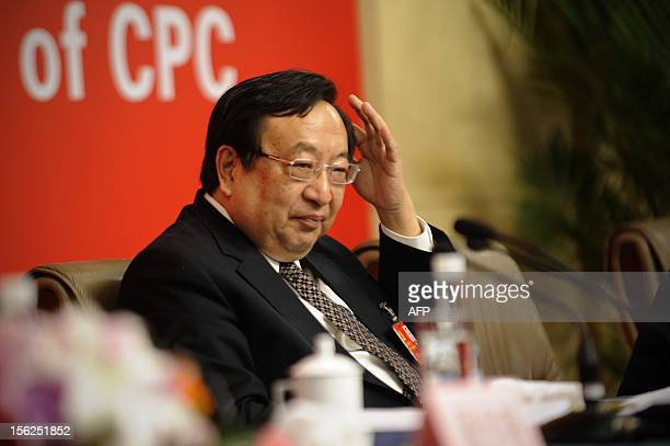 Vice Chairman and Deputy Secretary of the CPC Party Committee of the National Development and Reform Commission, Zhu Zhixin reacts during a press...