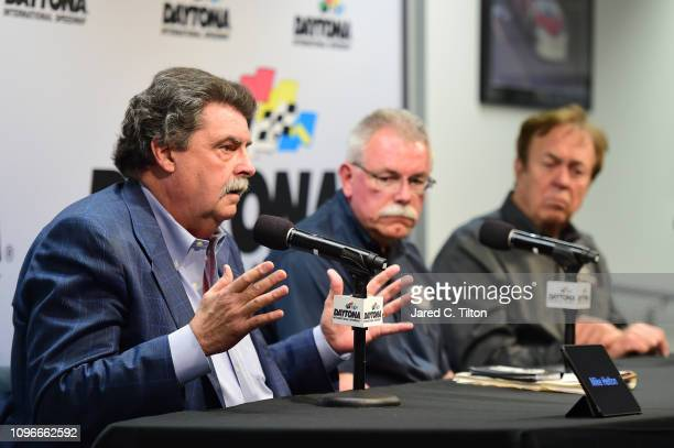 Vice Chairman Mike Helton ARCA President Ron Drager and John Menard speak during a press conference prior to practice for the Monster Energy NASCAR...