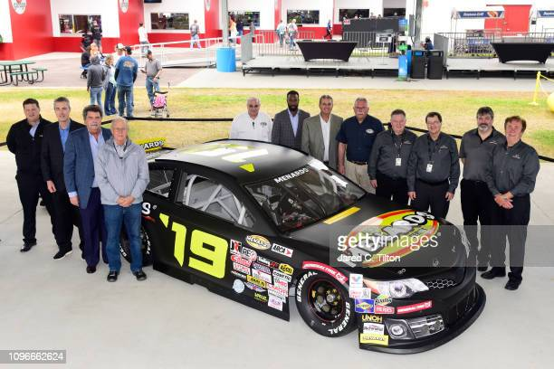Vice Chairman Mike Helton ARCA President Ron Drager and John Menard pose for a photo prior to practice for the Monster Energy NASCAR Cup Series 61st...
