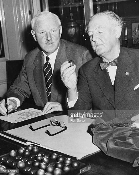 Vice Chairman of Birmingham FC David Wiseman making the draw for the second round of the FA Cup watched by Sir Stanley Rous at Football Association...