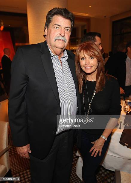 Vice Chairman of NASCAR Mike Helton and actress Roma Downey pose during the NASCAR Sprint Cup Series Champion's Dinner at the SW Steakhouse inside...