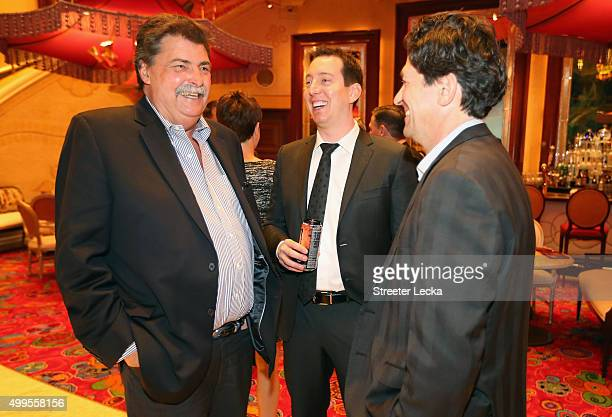 Vice Chairman of NASCAR Mike Helton and NASCAR Sprint Cup Series champion Kyle Busch react during the NASCAR Sprint Cup Series Champion's Dinner at...