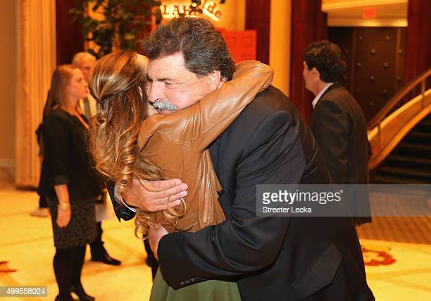 Vice Chairman of NASCAR Mike Helton hugs Samantha Busch during the NASCAR Sprint Cup Series Champion's Dinner at the SW Steakhouse inside Wynn Las...