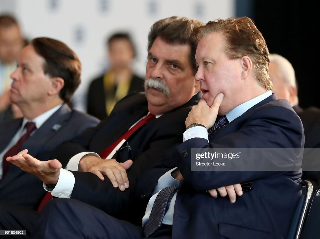 Vice Chairman of NASCAR, Mike Helton, speaks to NASCAR Chief Executive Officer and Chairman, Brian France, during the NACAR Hall of Fame Voting Day at NASCAR Hall of Fame on May 23, 2018 in Charlotte, North Carolina.