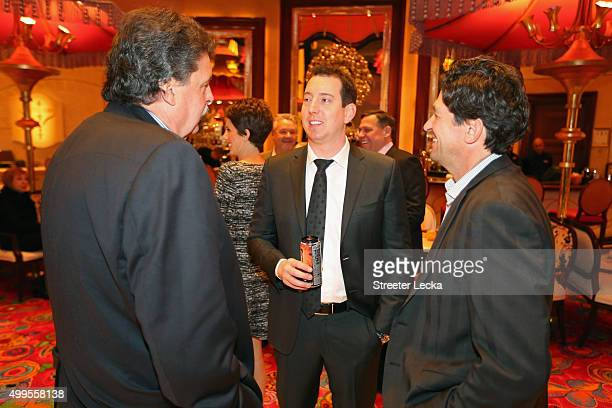 Vice Chairman of NASCAR Mike Helton speaks with NASCAR Sprint Cup Series champion Kyle Busch during the NASCAR Sprint Cup Series Champion's Dinner at...