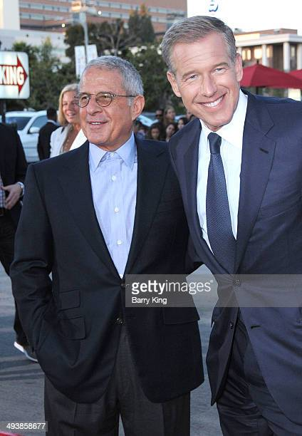 Vice Chairman of NBC Universal Ron Meyer and news anchor Brian Williams attend the premiere of 'Neighbors' on April 28 2014 at Regency Village...