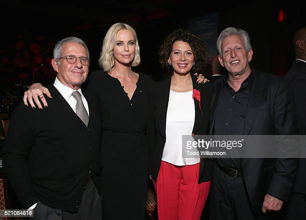 """Vice Chairman of NBCUniversal Ron Meyer actress Charlize Theron and Universal Pictures Chairman Donna Langley attend the 2016 Will Rogers """"Pioneer of..."""