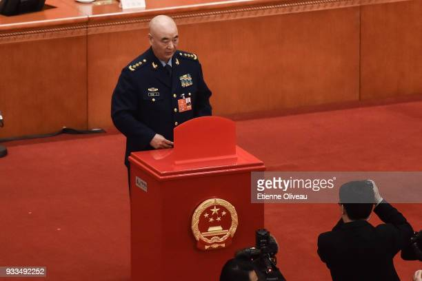 Vice chairman of the Central Military Commission of the People's Republic of China Xu Qiliang votes during the sixth plenary session of the National...