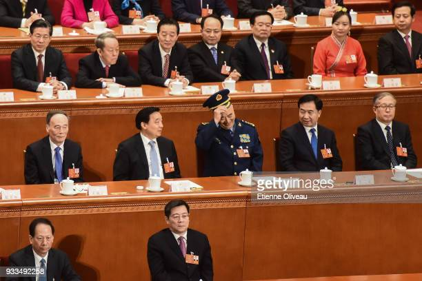 Vice chairman of the Central Military Commission of the People's Republic of China Xu Qiliang takes off his hat after he swore an oath during the...
