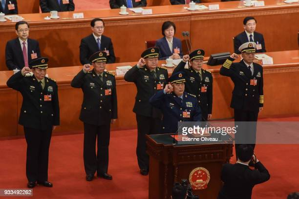 Vice chairman of the Central Military Commission of the People's Republic of China Xu Qiliang swears an oath with members of the Central Military...