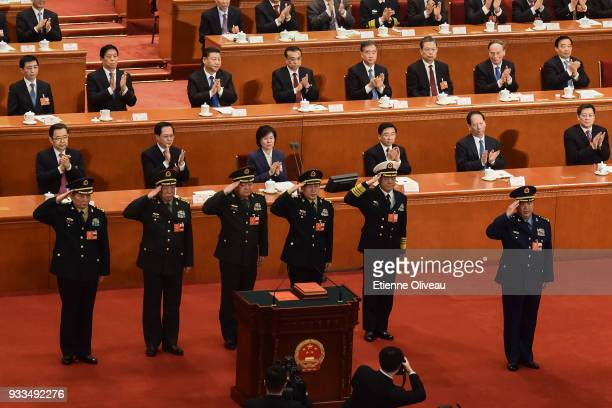Vice chairman of the Central Military Commission of the People's Republic of China Xu Qiliang with members of the Central Military Commission salute...