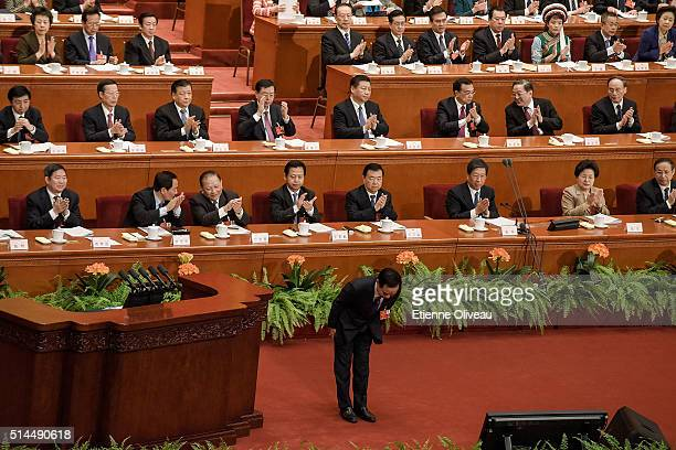 Vice Chairman of the National People's Congress Standing Committee Li Jianguo, salutes the audiance after he read his report during the Second...