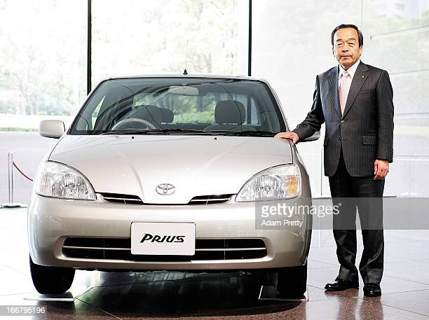 Vice Chairman of Toyota Takeshi Uchiyamada poses with Prius cars after speaking to the media on April 17 2013 in Tokyo Japan Toyota announces the...