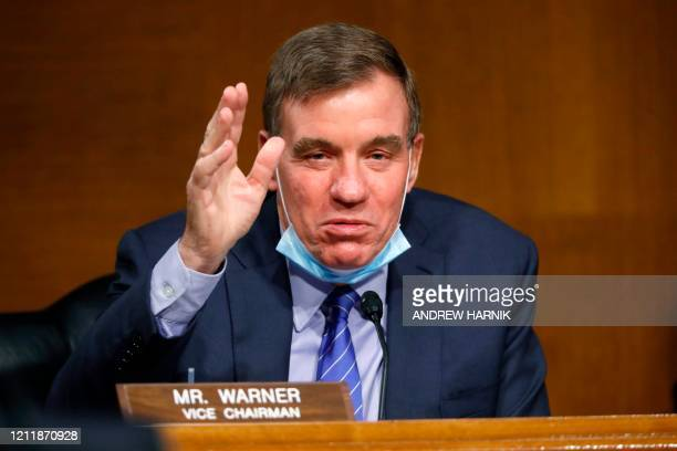 Vice Chairman Sen. Mark Warner, D-VA, gives opening remarks at a Senate Intelligence Committee hearing for a nomination for Rep. John Ratcliffe,...
