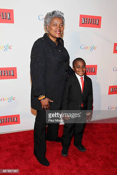 Vice Chairwoman of the Democratic National Committee Donna Brazile and 'Kid President' Robby Novak walk the red carpet at Google/Netflix White House...