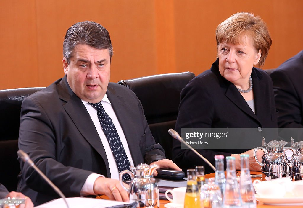 Vice Chancellor and Economy and Energy Minister Sigmar Gabriel (SPD) (L) and German Chancellor Angela Merkel (CDU) arrive for the weekly German federal Cabinet meeting on January 27, 2016 in Berlin, Germany. High on the meeting's agenda was discussion of the country's annual business report.