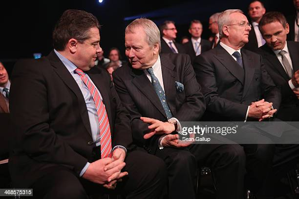 Vice Chancellor and Economy and Energy Minister Sigmar Gabriel chats with Porsche Governing Board Chairman Wolfgang Porsche as Volkwagen Chairman...