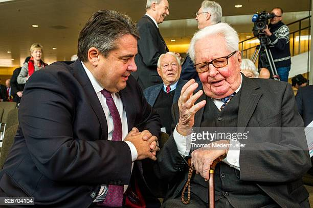 Vice Chancellor and Economy and Energy Minister Sigmar Gabriel talks to HansJochen Vogel former German minister and former lord mayor of Munich...