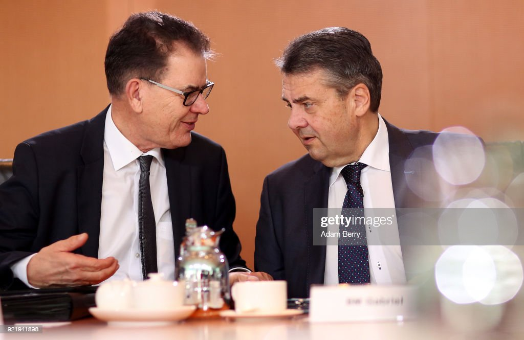 Vice Chancellor and Foreign Minister Sigmar Gabriel (SPD, R) and Development Minister Gerd Mueller (CSU) arrive for the weekly German federal Cabinet meeting on February 21, 2018 in Berlin, Germany. High on the meeting's agenda was discussion of legislation of volume levels of outdoor screenings of upcoming World Cup matches.