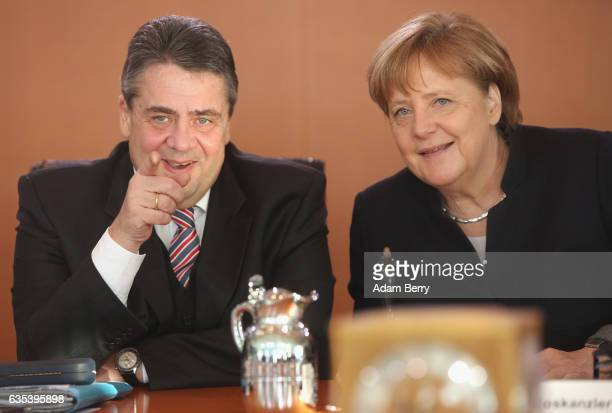 Vice Chancellor and Foreign Minister Sigmar Gabriel and German Chancellor Angela Merkel arrive for the weekly German federal Cabinet meeting on...