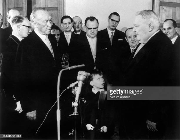 Vice chancellor Ludwig Erhard congratulates German chancellor Konrad Adenauer in Palais Schaumburg in Bonn on his 86th birthday on the 5th of January...