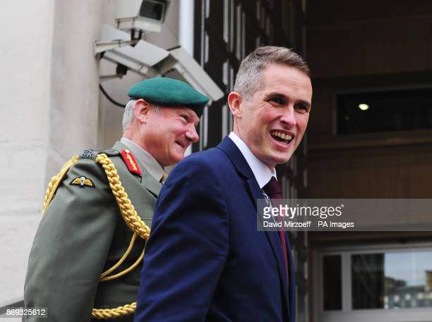 Vice chief of the Defence Staff General Sir Gordon Messenger greets Gavin Williamson outside the Ministry of Defence in London after he was named as...