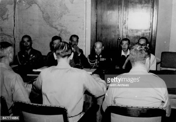 Vice Chief of the Imperial Japanese Army General Staff Lieutenant General Torashiro Kawabe sits with his delegation as they negotiate arrange terms...
