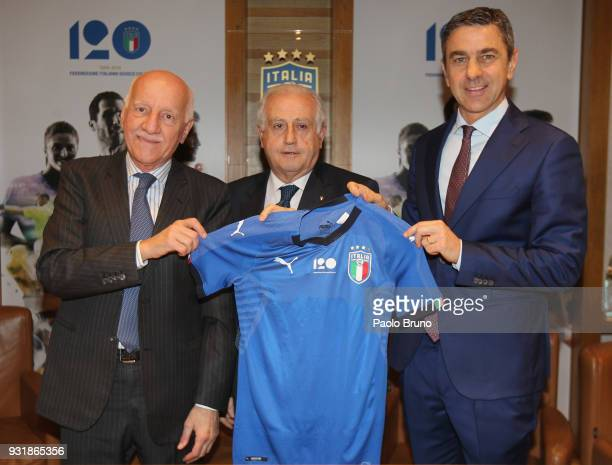 FIGC Vice Commissioner Angelo Clarizia FIGC Commissioner Massimo Fabbricini and FIGC Vice Commissioner Alessandro Costacurta pose with Italy jersey...