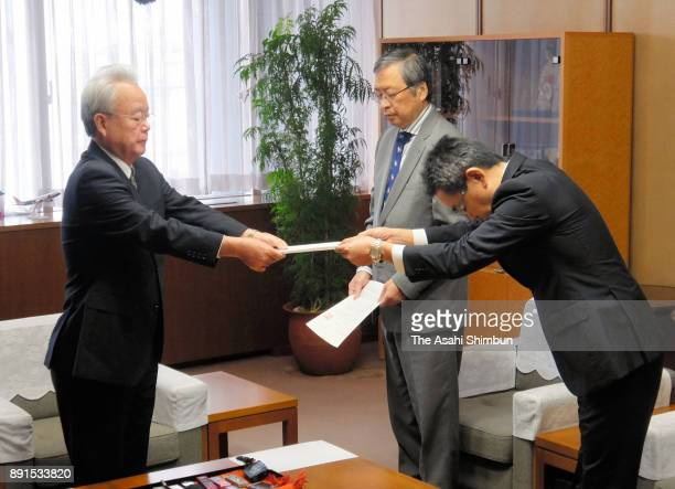 Vice Governor Moritake Tomikawa hands in the request that all US military aircraft flights in Okinawa be grounded until their safety is confirmed to...