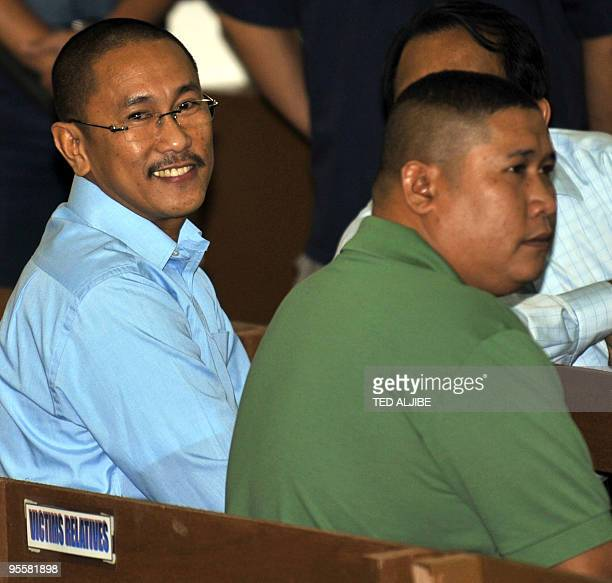Vice Mayor Esmael Mangudadato and his brother Khadaffy sit in the courtroom prior to the start of the hearing of Andal Ampatuan Jnr the prime suspect...