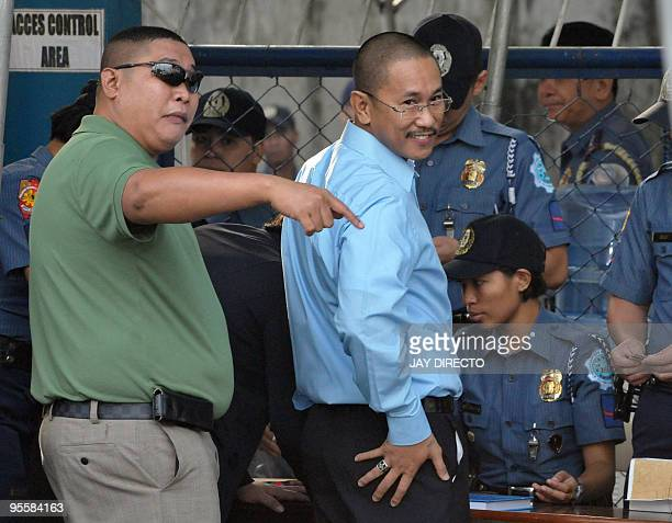 Vice Mayor Esmael Mangudadato and his brother Khadaffy wait to enter the courtroom prior to the start of the hearing of his rival Andal Ampatuan Jnr...