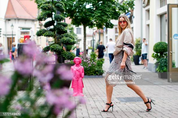 Vice Miss Germany 2020 and Influencer Lara Runarsson wearing a beige black and pink bomber jacket by Dorothee Schumacher a beige black and pink aline...