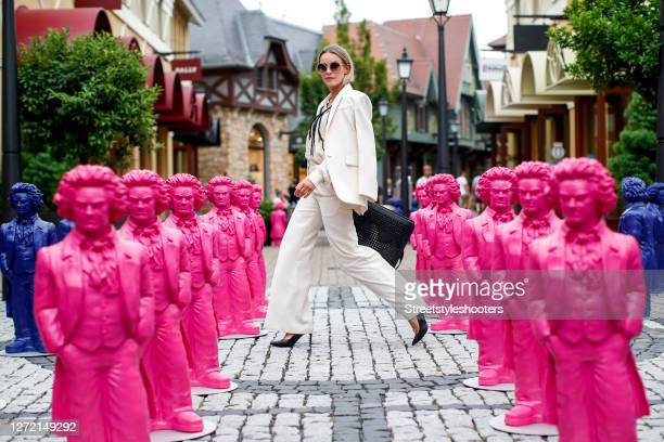 Vice Miss Germany 2020 and Influencer Lara Runarsson wearing a cream colored blazer and matching pants by Sandro Paris, a gold necklace by Thomas...
