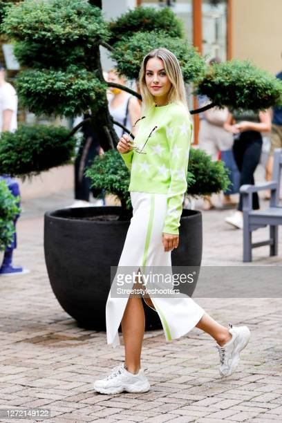 Vice Miss Germany 2020 and Influencer Lara Runarsson wearing a light green knitted pullover with white stars by Patrizia Pepe, a white knitted tube...