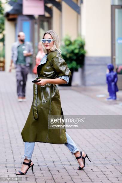 Vice Miss Germany 2020 and Influencer Lara Runarsson wearing a long khaki colored and blue/white checkered laminated reversible coat by Dorothee...