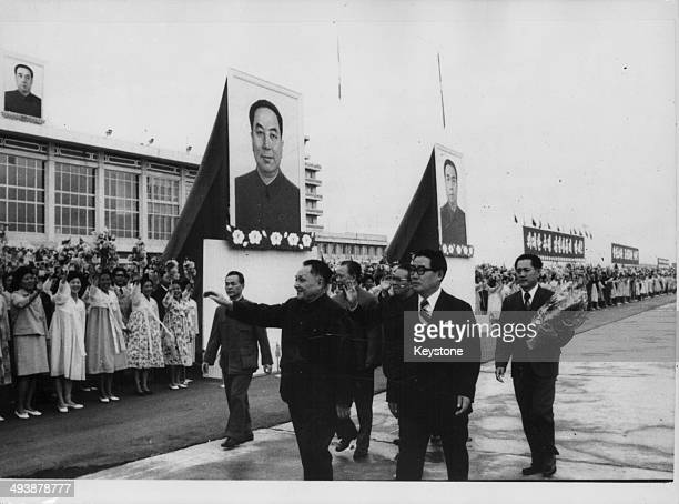 Vice Premier of China Deng Xiaoping in a parade with Korean President Kim Il Sung during a visit to Korea September 1978