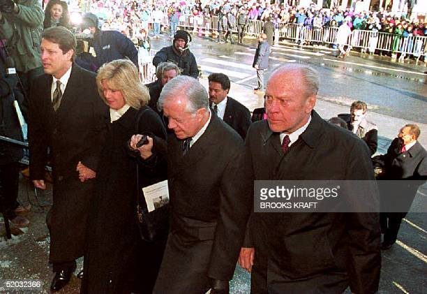S Vice President Al Gore and his wife Tipper join former US Presidents Jimmy Carter and Gerald Ford as they enter the funeral service for former US...