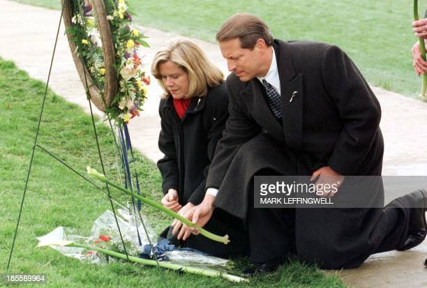 Vice President Al Gore and his wife Tipper lay flowers at a wreath in Clement Park for the victims of the Columbine High School shooting after...