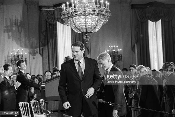 Vice President Al Gore and President Bill Clinton arrive at a White House ceremony in the East Room to unveil a new initiative to improve economic...